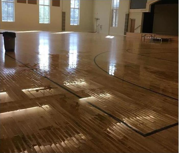 Water Damaged Gym Floors Before