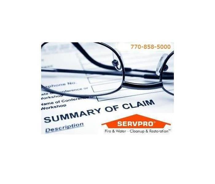 glasses on top on claim document